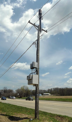wood utility pole with mounted equipment